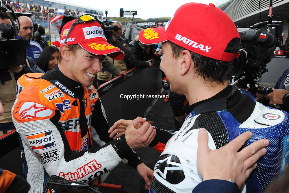 29.04.2012. Jerez, Spain. MotoGp of Spain at the Jerez de La Frontera circuit. Photo Casey Stoner and Jorge Lorenzo shake hands at the end of the race