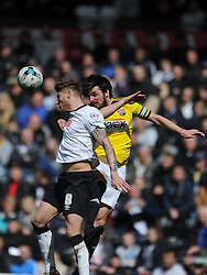 Brentford Jonathan Douglas holds of Derby Jeff Hendrick, Derby County v Brentford, Sy Bet Championship, IPro Stadium, Saturday 11th April 2015. Score 1-1,  (Bent 92) (Pritchard 28)<br /> Att 30,050