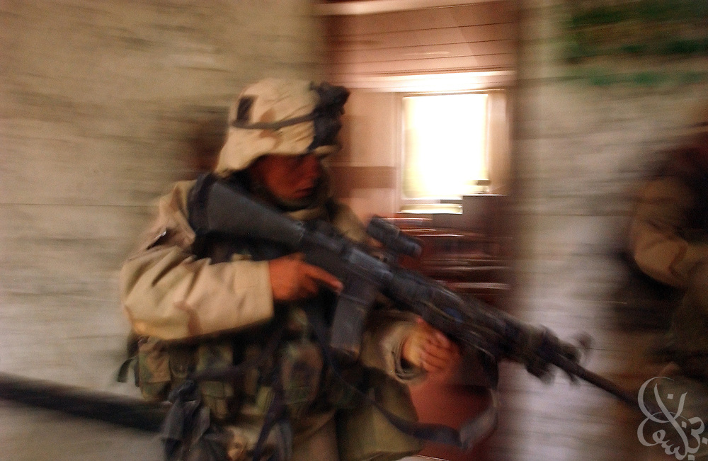 A U.S. Army 3rd Division 3-7 soldier sweeps through the VIP terminal of Baghdad International Airport during a dawn advance on the Iraqi capital April 4, 2003 in Baghdad.