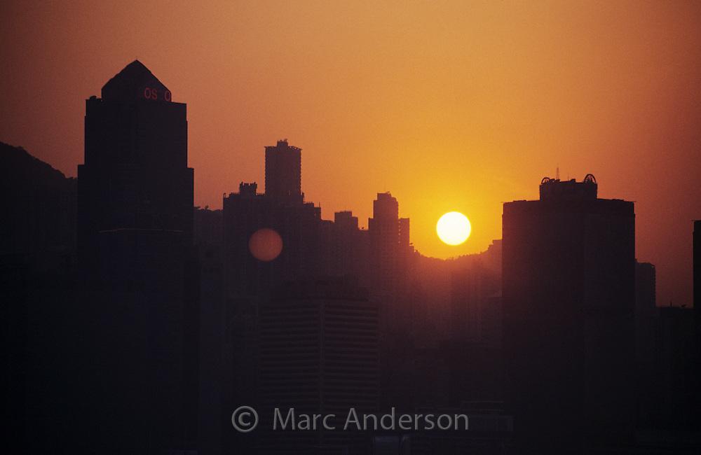 Silhouette of the Hong Kong skyline at sunset, Kowloon, Hong Kong, China.