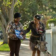 NORTH MIANI, FLORIDA, NOVEMBER 8, 2016<br /> Move On volunteers Lorna Shuford and her mother Delma Rodriguez  go knocking on doors of homes of voters in the North Miami area as they canvass for democratic votes.<br /> (Photo by Angel Valentin/Freelance)