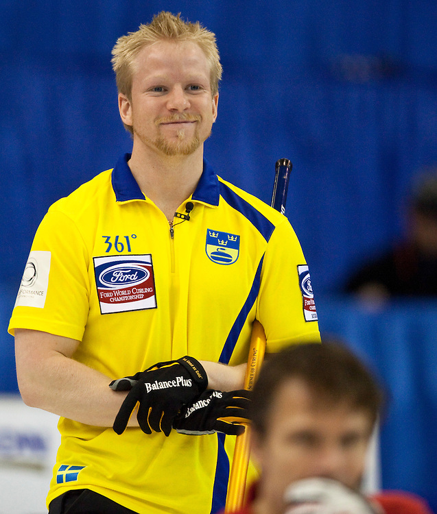 Swedish skip Niklas Edin, smiles during Sweden's bronze medal match at the Ford World Men's Curling Championships in Regina, Saskatchewan, April 10, 2011.<br /> AFP PHOTO/Geoff Robins