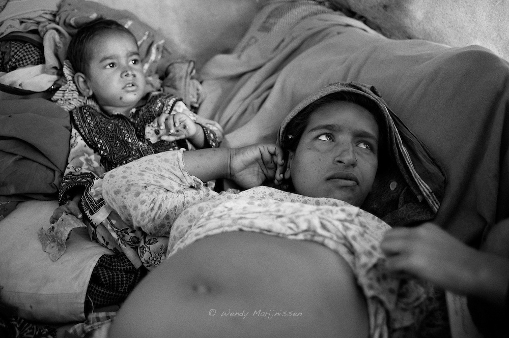 Hamida listens closely while the midwife tries to explain she might have to undergo a c-section in a nearby hospital. After already having had serious complications during her first two deliveries, the midwife doesn't want to take any risks and follows up Hamida's situation closely. Karachi, Pakistan, 2010