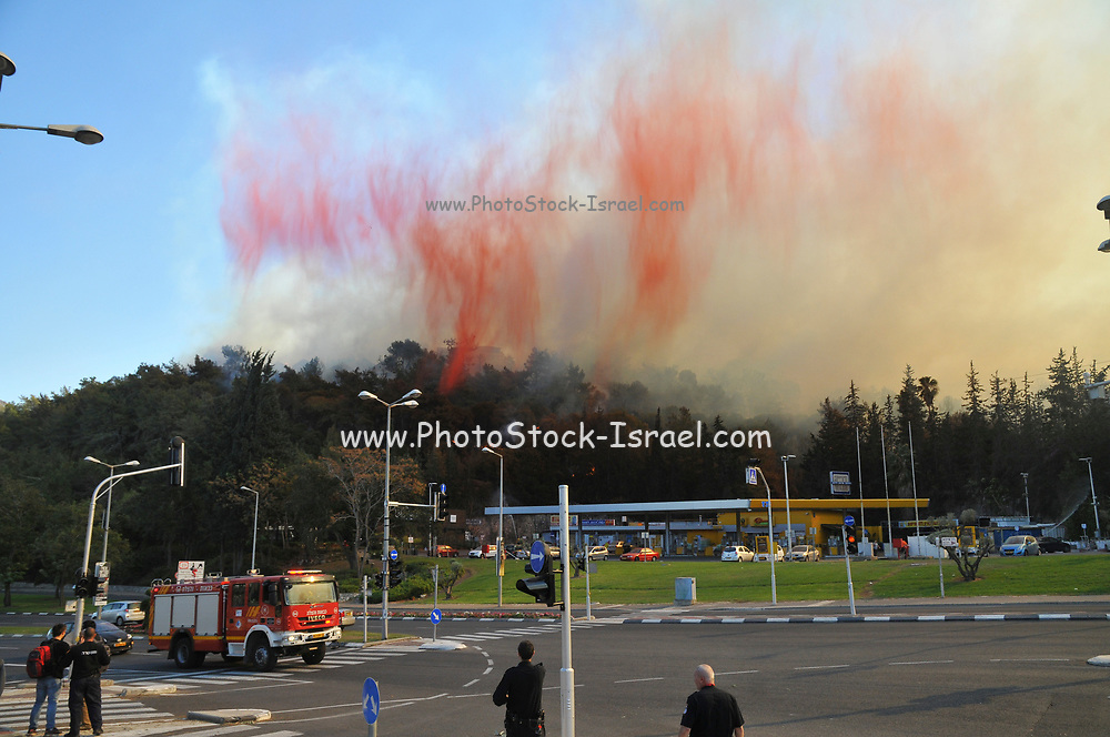 Aircraft dropping fire retardant on a wildfire in the city of Haifa, Israel in November 2016
