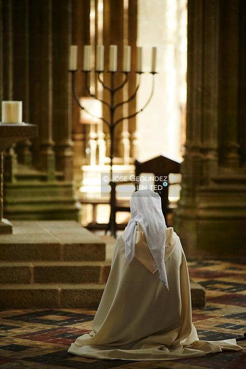 A religious woman at Abbey of Mont Saint Michel