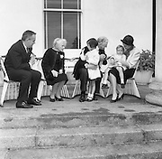 At Aras an Uachtarain, Sinead, Bean de Valera and President Eamon de Valera help Prince Rainier and Princess Grace with looking after Prince Albert and Princess Caroline. .14.06.1961