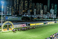 Happy Valley, Hong Kong, China- June 5, 2014: horse race at Happy Valley racecourse