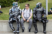 UNITED KINGDOM, London: 24 May 2019 <br /> Three friends, some dressed in cosplay outfits, relax outside of the ExCeL Centre in London earlier today for the MCM London Comic Con. Thousands of cosplay enthusiasts will come to the ExCeL Centre across the next three days to enjoy the convention.