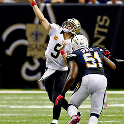 October 7, 2012; New Orleans, LA, USA; New Orleans Saints quarterback Drew Brees (9) throws as San Diego Chargers inside linebacker Takeo Spikes (51) pressures during the fourth quarter of a game at the Mercedes-Benz Superdome. The Saints defeated the Chargers 31-24. Mandatory Credit: Derick E. Hingle-US PRESSWIRE