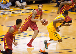 Iowa State Cyclones Bryce Dejean-Jones passes the ball up the floor against the West Virginia Mountaineers during the first half at the WVU Coliseum.