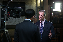 © Licensed to London News Pictures . 03/11/2015 . Oldham , UK . UKIP leader NIGEL FARAGE being interviewed for TV at the launch of the party's campaign for the seat of Oldham West and Royton , at the Railway Hotel in Royton . The by-election has been triggered by the death of MP Michael Meacher . Photo credit : Joel Goodman/LNP