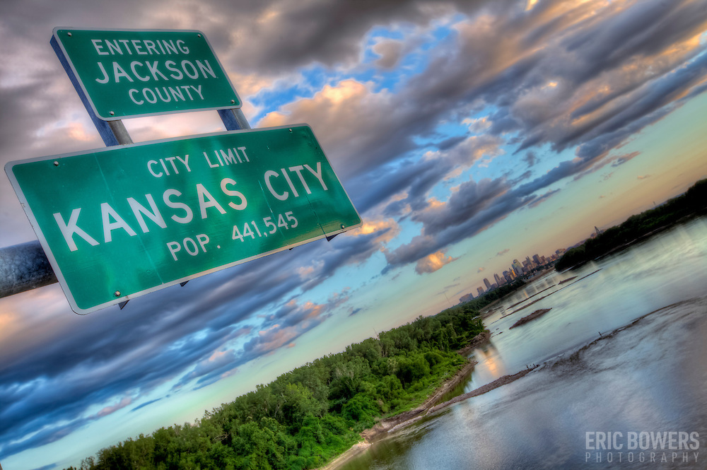 """Kansas City """"City Limits"""" sign on Chouteau Trafficway Bridge over the Missouri River in the evening."""