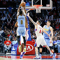 24 February 2016: Denver Nuggets guard Emmanuel Mudiay (0) takes a jump shot over Los Angeles Clippers guard J.J. Redick (4) and Los Angeles Clippers center DeAndre Jordan (6) during the Denver Nuggets 87-81 victory over the Los Angeles Clippers, at the Staples Center, Los Angeles, California, USA.