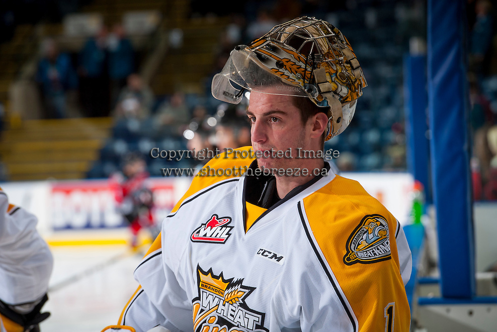 KELOWNA, CANADA - DECEMBER 3: Logan Thompson #1 of the Brandon Wheat Kings stands at the bench during warm up against the Kelowna Rockets on December 3, 2016 at Prospera Place in Kelowna, British Columbia, Canada.  (Photo by Marissa Baecker/Shoot the Breeze)  *** Local Caption ***