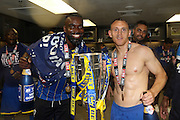 Barry Fuller (Captain) defender for AFC Wimbledon (2), Karleigh Osborne defender for AFC Wimbledon (22)  celebrate AFC Wimbledon winning promotion to league 1after the Sky Bet League 2 play off final match between AFC Wimbledon and Plymouth Argyle at Wembley Stadium, London, England on 30 May 2016. Photo by Stuart Butcher.