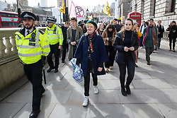 London, UK. 9th March, 2019. Claire Farrell accompanies other climate activists from Extinction Rebellion to pour artificial blood on the ground outside Downing Street as part of an act of civil disobedience named 'The Blood of Our Children' to call on the Government to take immediate steps to combat the current climate and ecological emergency.