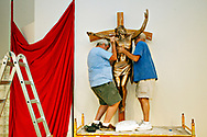 MELISSA LYTTLE   |   Times<br /> SP_340832_LYTT_NAYCROSS_1 (July 8, 2011, St. Petersburg, Fla.) With the help of volunteers Larry Dickie, left, and David Mattingly, St. Justin Martyr Catholic Church in Seminole is installing an unusual corpus - body of Christ - on the main cross in the church. The new sculpture shows Christ as crucified on one side of his body, with his wounds, and the other side will portray him as risen and pristine. The project has been two years in the making, and was the brainchild of  Father Michael O'Brien. [MELISSA LYTTLE, TIMES]