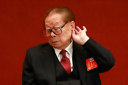 epa06272493 Former Chinese President Jiang Zemin scratches his ear during the opening ceremony of the 19th National Congress of the Communist Party of China (CPC) at the Great Hall of the People (GHOP) in Beijing, China, 18 October 2017. China holds the 19th Congress of the Communist Party of China, the country's most important political event where the party's leadership is chosen and plans are made for the next five years. Xi Jinping is expected to remain as the General Secretary of the Communist Party of China for another five-year term.  EPA-EFE/HOW HWEE YOUNG