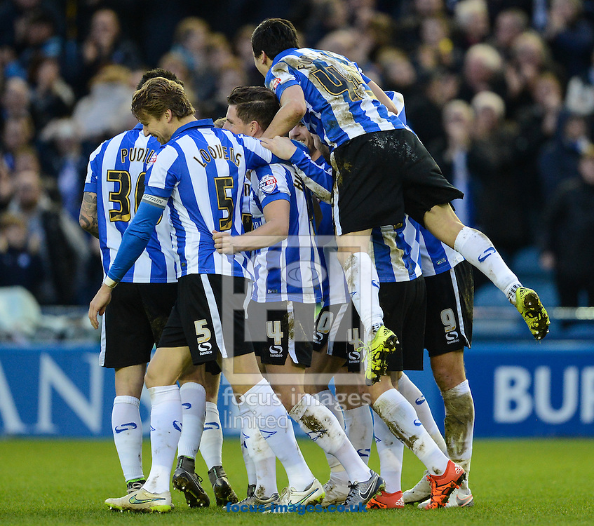 Kieran Lee of Sheffield Wednesday is mobbed as he celebrates scoring to make it 2-0 during the Sky Bet Championship match at Hillsborough, Sheffield<br /> Picture by Richard Land/Focus Images Ltd +44 7713 507003<br /> 26/12/2015