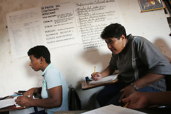 "Maria Ascanio(center),46, and other students participate in a Mision Rivas class in Catia, a poor slum in Caracas. The class is funded by PDVSA and gives people who were unable to finish highschool a chance to earn a highschool equivalency degree. Since the removal of nearly 18,000 workers after an oil strike in Venezuela in 2002, PDVSA, the state run oil company has gone through drastic changes.  Struggling to replace the dismissed workers and return production to pre-strike quantities, PDVSA has also undertaken the financing and coordination of huge social programs.  PDVSA has invested billions of dollars in various education, food, medicine and infrastructure projects, calling itself the ""new"" PDVSA."
