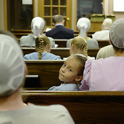 Brittaney Mast, center, looks toward the back of the room during a evening church service and meeting at the Mennonites Cuba Christian Brotherhood Church, a small building adjacent to the 5-Star Building in Cuba, Missouri on Wednesday, Sept. 28, 2016. (Photo by Keith Birmingham Photography)