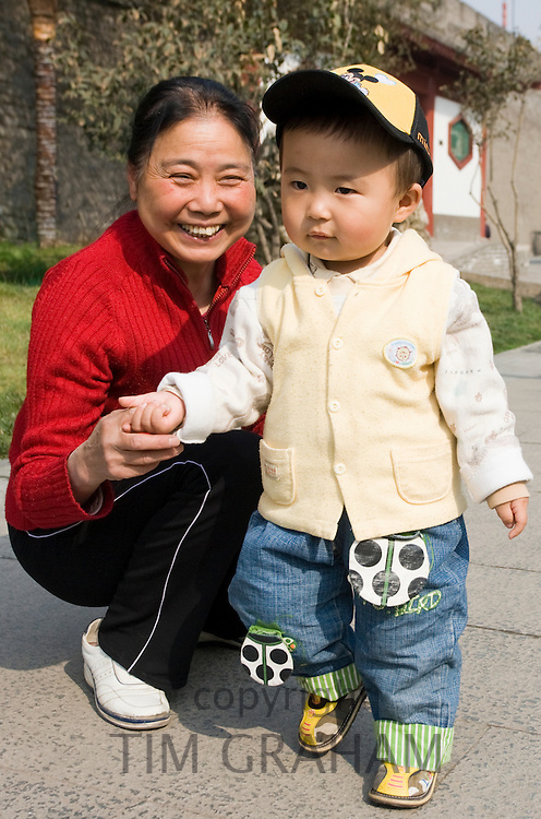 Grandmother and child in park by City Wall, Xian. China has a one child family planning policy to reduce population.