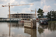 Flooding in front of  Heights at Park Row apartment building on Houston's west side across from the city's Energy Corridor. The area remained flooded days after Hurricane Harvey's rain stopped. Floodwater here was caused by the release of water from the Addicks Reservoir. An oil sheen coated the top of the water. Cranes in the backround are a reminder that much of Houston was developed and goes on being developed with few regualtions was  factor many say contributed to the vast flooding.