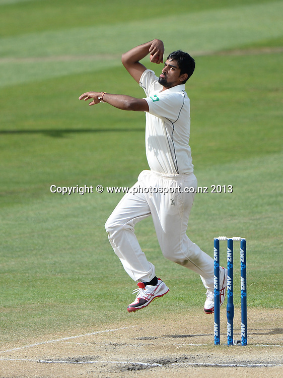 New Zealand leg spinner Ish Sodhi bowling on Day 4 of the 1st cricket test match of the ANZ Test Series. New Zealand Black Caps v West Indies at University Oval in Dunedin. Friday 6 December 2013. Photo: Andrew Cornaga/www.Photosport.co.nz