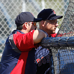 February 19, 2011; Fort Myers, FL, USA; Boston Red Sox first baseman Adrian Gonzalez (front) talks with manger Terry Francona during spring training at the Player Development Complex.  Mandatory Credit: Derick E. Hingle