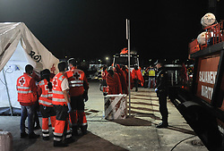 May 6, 2018 - Malaga, Spain - Migrants who were rescued from a dinghy in the Mediterranean Sea, walk past after their arrival at Port of Malaga. Members of the Spanish Maritime Safety rescued in this early morning a total of 110 migrants from two boats near the Malaga coast. (Credit Image: © Jesus Merida/SOPA Images via ZUMA Wire)