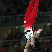 Gymnastics - Olympics: Day 3  Kohei Uchimura #154 of Japan performing his Horizontal Bar routine during the Artistic Gymnastics Men's Team Final at the Rio Olympic Arena on August 8, 2016 in Rio de Janeiro, Brazil. (Photo by Tim Clayton/Corbis via Getty Images)