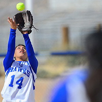 050114  Adron Gardner/Independent<br /> <br /> Laguna Acoma Hawk Kaitlin Lucero (14) catches an  Estancia Bear fly ball during the district championship at Laguna Acoma High School in Casa Blanca Thursday.