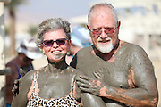 Israel, Dead Sea, tourists cover themselves in therapeutic mud in order to benefit from claimed skin care properties of this mud. (Model Release Available)