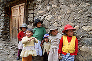 "Children stand by a wall in Llamac (10,000 feet elevation), Cordillera Huayhuash, Andes Mountains, Peru, South America. Campesinos are the rural, country folk of Peru. Published in ""Climbs and Treks in the Cordillera Huayhuash of Peru"" guidebook by Jeremy Frimer 2005, ISBN #0-9733035-5-7, Elaho Publishing (www.elaho.ca)."