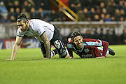 Burnley midfielder George Boyd  picks himself up after a challenge from Derby County midfielder Bradley Johnson  during the Sky Bet Championship match between Burnley and Derby County at Turf Moor, Burnley, England on 25 January 2016. Photo by Simon Davies.