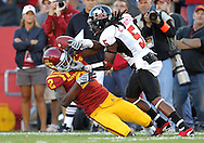 September 2 2010: Iowa State Cyclones wide receive Sedrick Johnson (2) tries to pull in a pass as Northern Illinois Huskies defensive back Chris Smith (5) defends during the first half of the NCAA football game between the Northern Illinois Huskies and the Iowa State Cyclones at Jack Trice Stadium in Ames, Iowa on Thursday September 2, 2010.