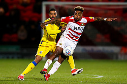 Mallik Wilks of Doncaster Rovers takes on Tareiq Holmes-Dennis of Bristol Rovers - Mandatory by-line: Robbie Stephenson/JMP - 26/03/2019 - FOOTBALL - Keepmoat Stadium - Doncaster, England - Doncaster Rovers v Bristol Rovers - Sky Bet League One