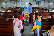 06 APRIL 2012 - HAI PHONG, VIETNAM: The 3rd class car on the Hanoi to Hai Phong Express train. The train has three classes: 1st, 2nd and 3rd. Tickets cost between $3(US) and $2(US) one way. The Hanoi to Hai Phong Express Train runs several times a day between Long Bien Station in Hanoi and the Hai Phong Station. Hanoi is the capital of Vietnam and Hai Phong is the 4th largest city in Vietnam. Hai Phong is the principal industrial port in the northern part of Vietnam. It was heavily bombed and mined during the American War (what Americans call the Vietnam War).   PHOTO BY JACK KURTZ