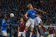 Filip Helander of Rangers FC tangles in the air with Uche Ikpeazu of Hearts during the Betfred Scottish League Cup semi-final match between Rangers and Heart of Midlothian at Hampden Park, Glasgow, United Kingdom on 3 November 2019.