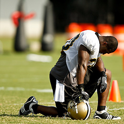 August 1, 2010; Metairie, LA, USA; New Orleans Saints running back Lynell Hamilton (30) kneels due to the heat during a training camp practice at the New Orleans Saints practice facility. Mandatory Credit: Derick E. Hingle