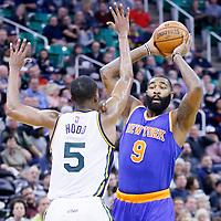09 December 2015: New York Knicks forward Kyle O'Quinn (9) looks to pass the ball over Utah Jazz guard Rodney Hood (5) during the Utah Jazz 106-85 victory over the New York Knicks, at the Vivint Smart Home Arena, Salt Lake City, Utah, USA.