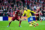 17.11.2015. Copenhagen, Denmark. <br /> Pierre Bengtsson (R) of Sweden fights for the ball with Yussuf Poulsen (L) of Denmark during their UEFA EURO 2016 play-off second leg round match at the Telia Parken Stadium. <br /> Photo: © Ricardo Ramirez.
