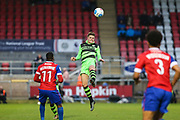 Forest Green Rovers Charlie Cooper(20) heads the ball clear during the Vanarama National League first leg play off match between Dagenham and Redbridge and Forest Green Rovers at the London Borough of Barking and Dagenham Stadium, London, England on 4 May 2017. Photo by Shane Healey.