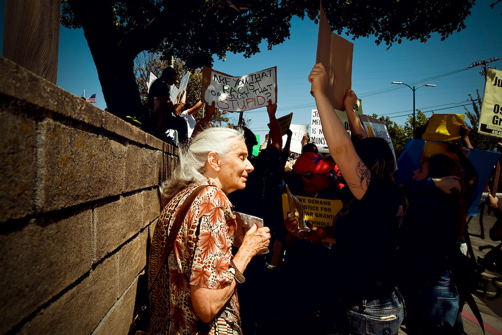 Older female protester at Johannes Mehserle rally participates on opposing side in Walnut Creek, CA.  Copyright 2010 Reid McNally.