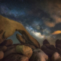Milky Way over Arch Rock in Joshua Tree National Park, California.