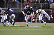 Ole Miss quarterback Bo Wallace (14) escpaes Vanderbilt linebacker Archibald Barnes (15) at Vaught-Hemingway Stadium in Oxford, Miss. on Saturday, November 10, 2012. (AP Photo/Oxford Eagle, Bruce Newman)