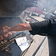 Josh Moore grilling hamburgers on south main street for volunteer and emergency  personnel working to clean up historic Port Deposit Saturday, Sept. 10, 2011, as flooding from the Susquehanna River continues. (AP Photo/Saquan Stimpson)