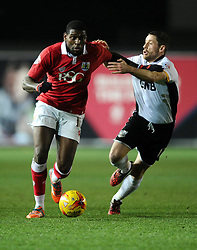 Bristol City's Jay Emmanuel-Thomas battles for the ball with Port Vale's Michael Brown  - Photo mandatory by-line: Joe Meredith/JMP - Mobile: 07966 386802 - 10/02/2015 - SPORT - Football - Bristol - Ashton Gate - Bristol City v Port Vale - Sky Bet League One