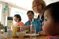 Lisa and Ralph Brown are having lunch with Alison their newly adopted daughter. It is the the second time they adopt in China.