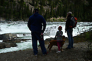 The Conrow family with their dog Reba at Kootenai Falls in Lincoln County, northwest Montana.